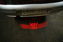 проектор на бампер DECEPTICON,проектор логотипа DECEPTICON для заднего бампера,проектор логотипа DECEPTICON на задний бампер,светодиодный проектор DECEPTICON,светодиодный проектор логотипа DECEPTICON,рекламный проектор DECEPTICON,след тени логотипа автомо
