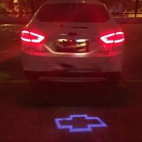 проектор логотипа chevrolet для заднего бампера,проектор логотипа chevrolet на задний бампер,светодиодный проектор chevrolet,светодиодный проектор логотипа chevrolet,рекламный проектор chevrolet,след тени логотипа автомобиля c