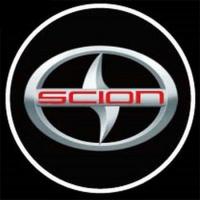 Подсветка логотипа в двери SCION,подсветка дверей с логотипом SCION,Штатная подсветка SCION,подсветка дверей с логотипом авто SCION,светодиодная подсветка логотипа SCION в двери,Лазерные проекторы SCION в двери,Лазерная подсветка SCION